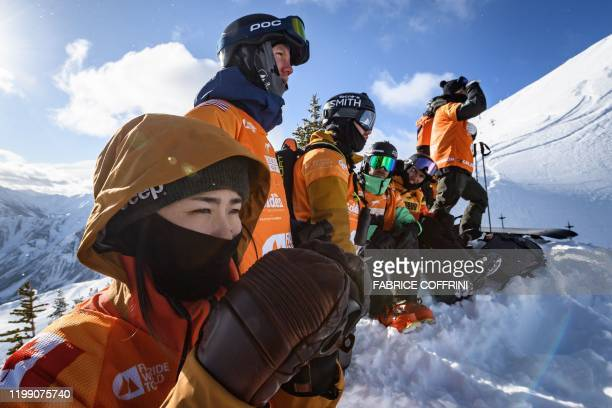 Freeride racers face the competition site the Ozone face during the face check ahead of the second stage of the Freeride World Tour skiing and...