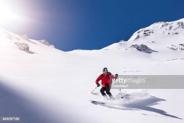 Freerider skier running downhill  Mount Hochkönig  in Alps