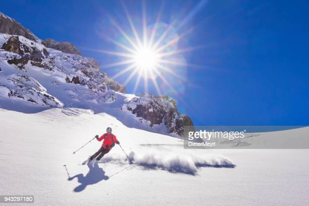 Freerider skier running downhill - Ochsenkar at Mount Hochkönig  in Alps