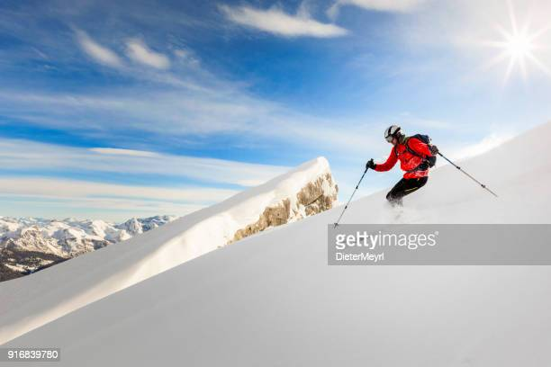 Freerider skier running downhill - Watmann, Nationalpark Berchtesgaden in Alps