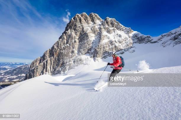freerider skier running downhill - watzmann, nationalpark berchtesgaden in alps - skiing stock pictures, royalty-free photos & images