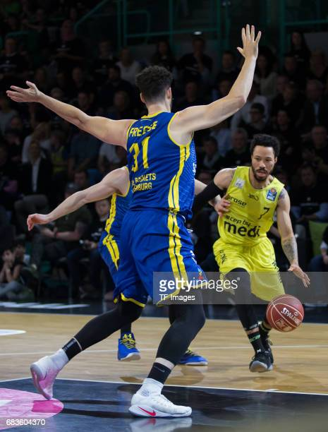Freese Jannik of Oldenburg and Anderson kyan battle for the ball during the easyCredit BBL match between medi bayreuth and EWE Baskets Oldenburg at...