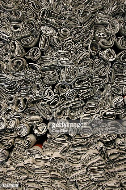 Freesheet newspapers rolled and piled up to make the structure of a house on March 4, 2008 in London, England. Artist Sumer Erek is building a house...