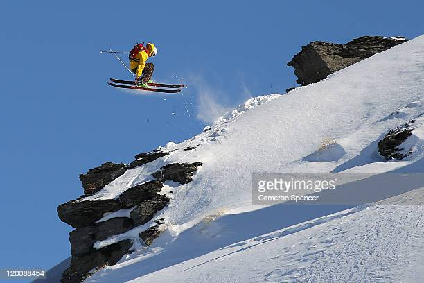 Freeskier Charlie Timmins of Australia performs an air in backcountry near Treble Cone ski resort ahead of the World Heli Challenge on July 30 2011...
