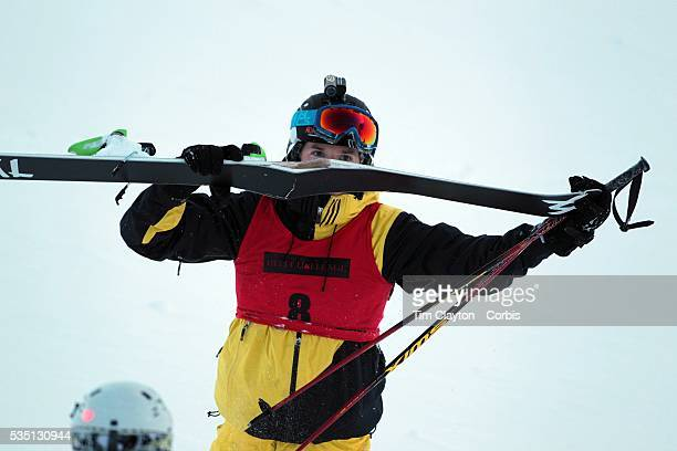 Freeskier Ted Davenport of the United States breaks a ski on his first run after launching off a drop during the World Heli Challenge Extreme Day at...