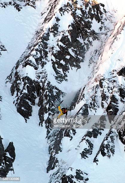 Freeskier Ted Davenport of the United States crashes and breaks a ski on his first run after launching off a drop during the World Heli Challenge...