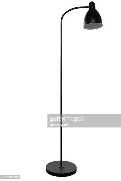 Free-standing tall black floor lamp, isolated on white background