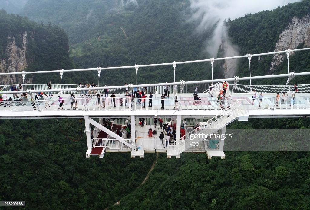 Freestyle Bungee Jumping From Glass-bottom Bridge At Zhangjiajie Grand Canyon : News Photo