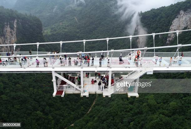 A freestyle bungee jumping competition is held on the glassbottom bridge at Zhangjiajie Grand Canyon on May 26 2018 in Zhangjiajie Hunan Province of...