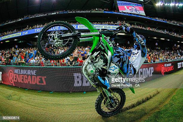 Freestyle Moto X riders perform during the Big Bash League match between the Melbourne Renegades and the Perth Scorchers at Etihad Stadium on...