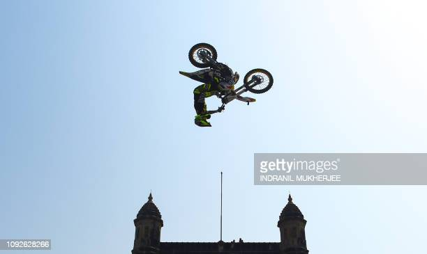 A Freestyle Motocross rider performs stunts during the Red Bull FMX Jam 2019 at the Gateway of India in Mumbai on February 2 2019