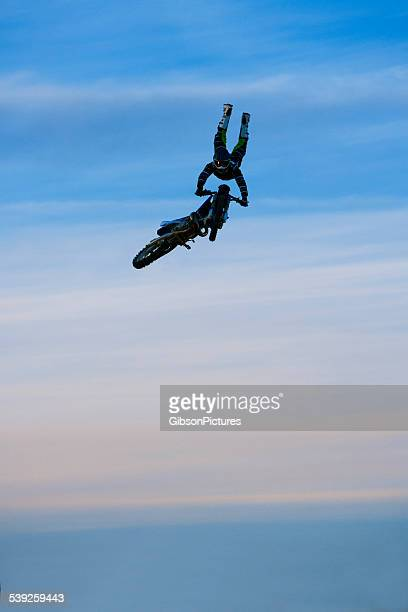 freestyle motocross rider - stunt stock photos and pictures