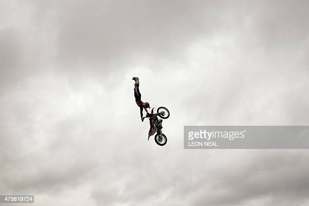 Freestyle motocross rider Steve Sommerfield jumps his KTM motorbike in London on June 2 2015 to promote the upcoming Night of Jumps event on...
