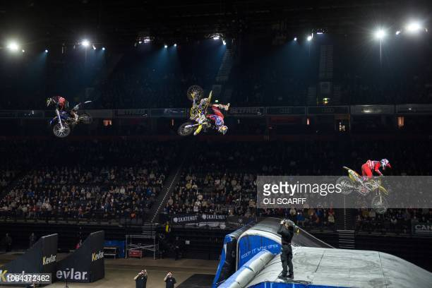 Freestyle motocross riders perform stunts in Manchester Arena during Nitro Circus' You Got This Tour in Manchester, northern England on November 22,...