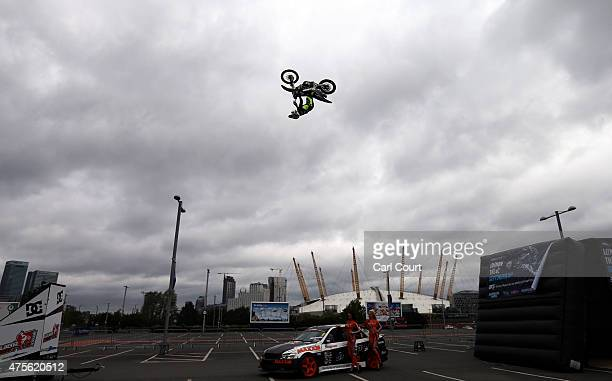 Freestyle motorcross rider James Squibb performs a jump during a photocall for the Night of the Jumps Freestyle MX World Championship event on June 2...