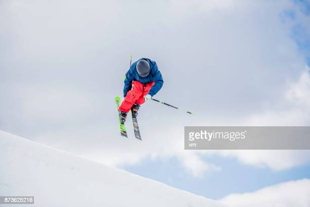 freestyle skier in mid-air during a half pipe jump - half pipe stock pictures, royalty-free photos & images