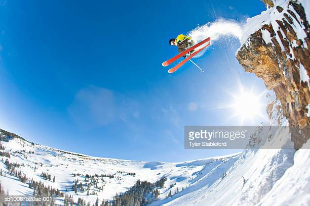 freestyle skier jumping off cliff - colorado stock pictures, royalty-free photos & images