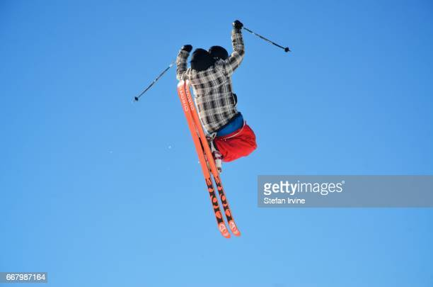 A freestyle skier performs an aerial trick as he launches from a jump in Les Arcs France