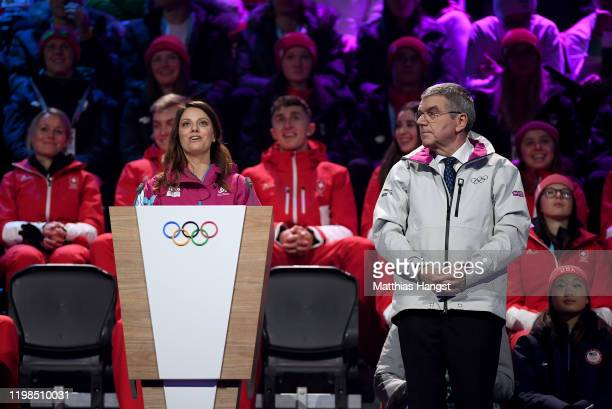 Freestyle Skier Virginie Faivre of Switzerland and President of the International Olympic Committee Thomas Bach speak during the Opening Ceremony of...