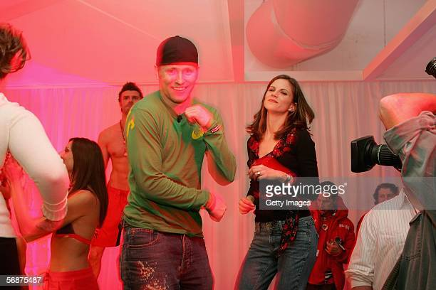 Freestyle skiier Jerrit 'Speedy' Peterson of the United States dances with Natalie Morales of NBC's Today show at the Budweiser Red Party on February...