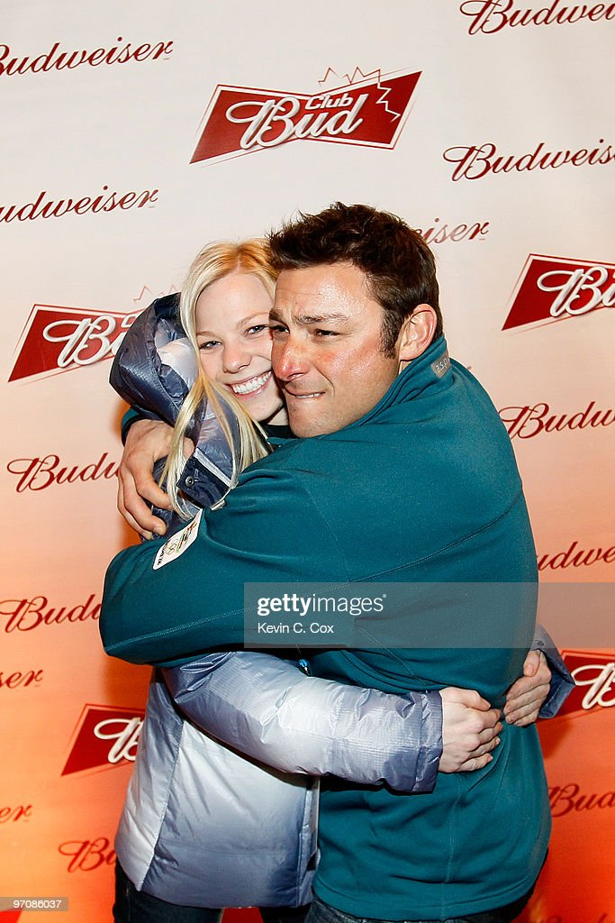 Freestyle skiier Lacy Schnoor hugs her boyfriend, Australian aerial skiing coach, Jerry Grossi, as they arrives at the Club Bud Budweiser Party on February 25, 2010 at the Commodore Ballroom in Vancouver, Canada.