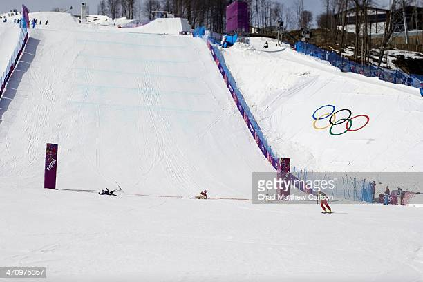 2014 Winter Olympics Russia Egor Koroktov in action crossing finish line as Canada Brady Leman Sweden Victor Oehling Norber and Finland Jouni...