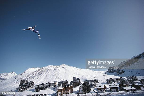 Freestyle skiing competitor performs an aerial routine during the Freestyle ski event on 13 February 1992 at the XVI Olympic Winter Games in Tignes,...