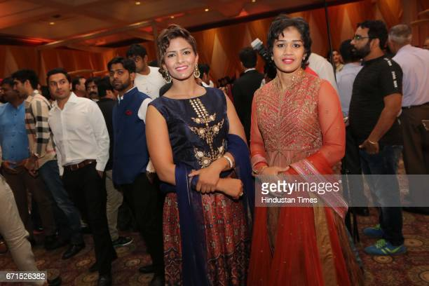 Freestyle wrestlers Geeta and Babita Phogat during the wedding reception of INLD MP Dushyant Chautala with Meghna Ahlawat at Ashoka Hotel on April 20...