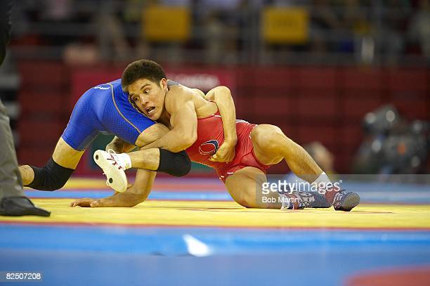 2008 Summer Olympics USA Henry Cejudo in action vs vs Japan Tomohiro Matsunaga during Men's Freestyle 55kg Gold Medal Match at China Agricultural...