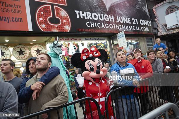 Beat the Streets Gala View of performer in Minnie Mouse costume other spectators looking on during USA vs Cuba competition in Duffy Square at Times...