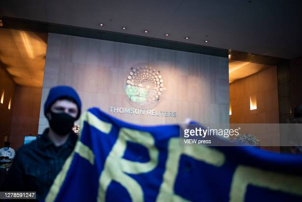 FreeThemAllFridays activists protest at the headquarters of the Thompson Reuters news agency for contracting with the Immigration and Customs...