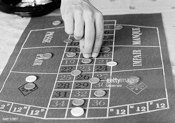 Freetime, gambling, roulette table with chips -