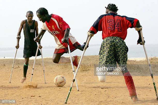 Maxwell Fornah capitaine of the Sierra Leone civil war amputees football team vies with other disabled players 07 April 2006 at a beach in Freetown...