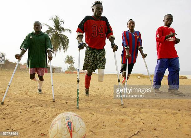 Players of the Sierra Leone civil war amputees football team pose 07 April 2006 at a beach in Freetown Former Liberian president Charles Taylor...