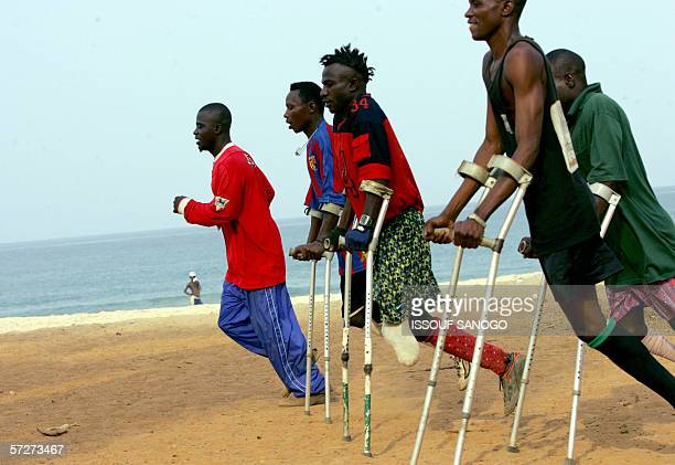 Players of the Sierra Leone civil war amputees football team train 07 April 2006 at a beach in Freetown Former Liberian president Charles Taylor...