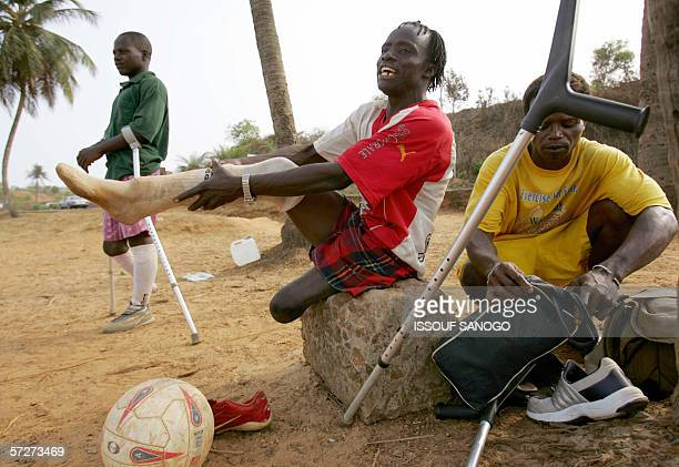 Players of the Sierra Leone civil war amputees football team get ready prior a match 07 April 2006 at a beach in Freetown Former Liberian president...