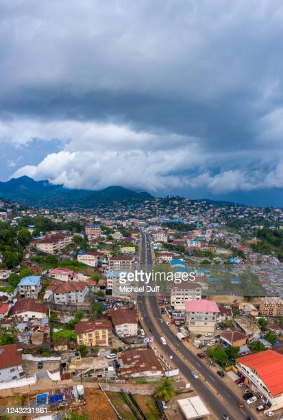 freetown, sierra leone with storm clouds - sierra leone stock pictures, royalty-free photos & images