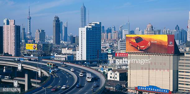 freeway and city buildings - shanghai billboard stock pictures, royalty-free photos & images