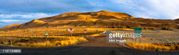 freeway onramp with hills in background - pasco stock photos and pictures