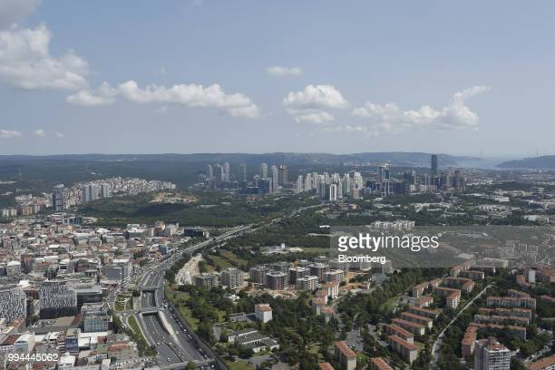 A freeway stretches past the northeastern suburbs of Istanbul towards the Maslak business district seen from the top of Saphire tower in the district...