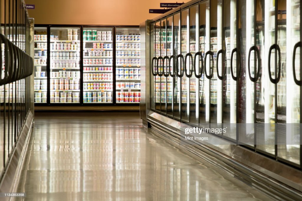 Freezer cases in supermarket : Stock Photo