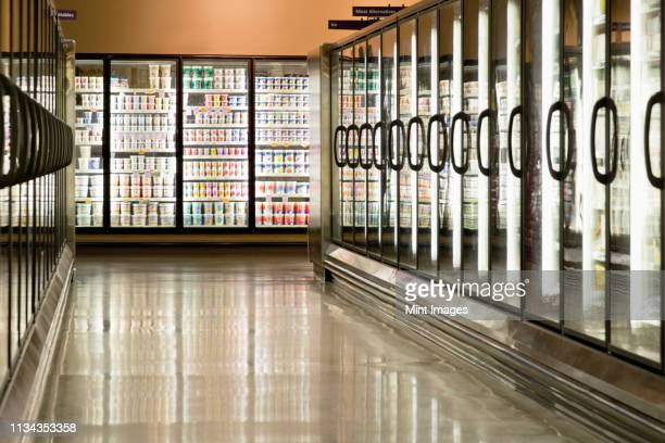 freezer cases in supermarket - groceries stock pictures, royalty-free photos & images