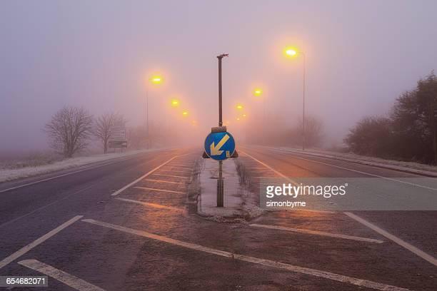 Freezing fog road in morning, Cambridgeshire, England, UK