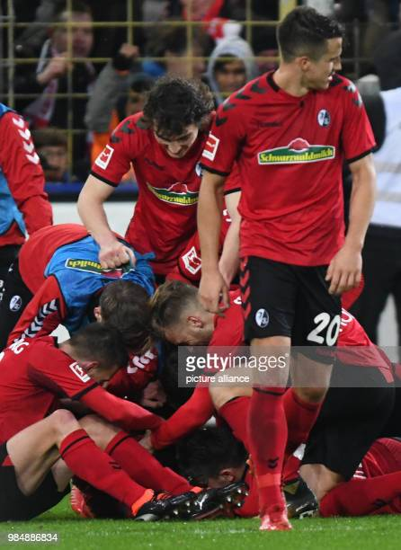 SC Freiburg and RB Leipzig face off in a Bundesliga match at Freiburg/Breisgau Germany 20 January 2018 Freiburg celebrates its 20 Due to the...
