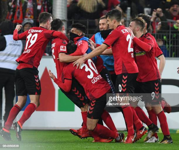 SC Freiburg and RB Leipzig face off in a Bundesliga match at Freiburg/Breisgau Germany 20 January 2018 Freiburg celebrates their 20 Due to the...