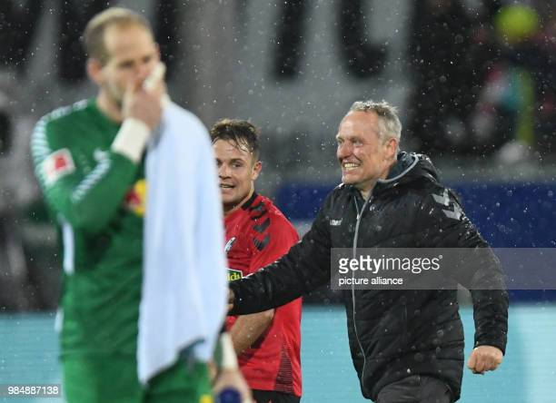 SC Freiburg and RB Leipzig face off in a Bundesliga match at Freiburg/Breisgau Germany 20 January 2018 Leipzig's keeper Peter Gulacsi wipes his brow...