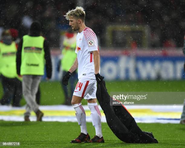 SC Freiburg and RB Leipzig face off in a Bundesliga match at Freiburg/Breisgau Germany 20 January 2018 Leipzig's Kevin Kampl walks across the pitch...
