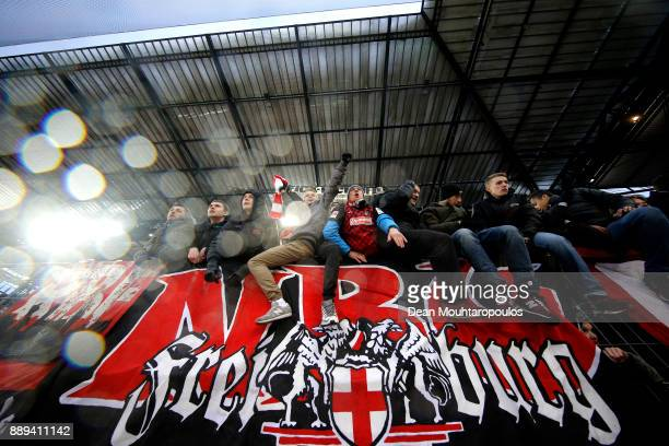 Freiburg celebrate their side's win following the Bundesliga match between 1 FC Koeln and SportClub Freiburg at RheinEnergieStadion on December 10...