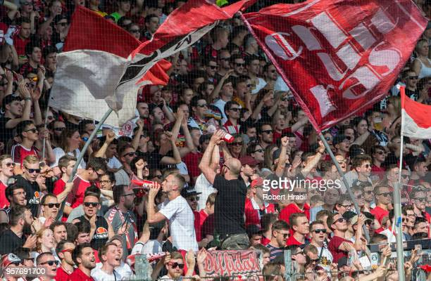 Freiburg fans celebrate the win during the Bundesliga match between SportClub Freiburg and FC Augsburg at SchwarzwaldStadion on May 12 2018 in...