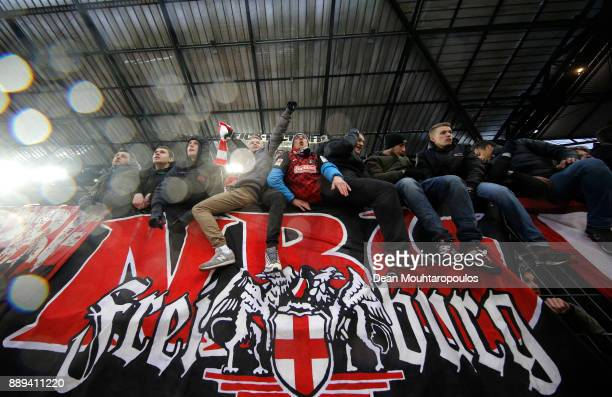 Freiburg fans celebrate their side's win following the Bundesliga match between 1 FC Koeln and SportClub Freiburg at RheinEnergieStadion on December...